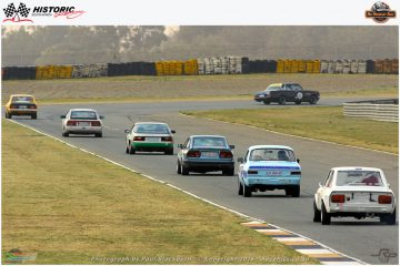 The long queue of Historic Handicap cars catching up in the closing stages of the race